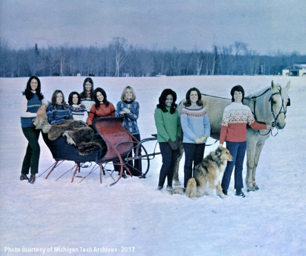 The 1971 queen candidates pose with a horse and sleigh.