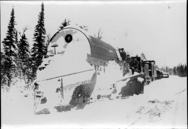 Strange train plowing through snow