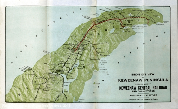 Green railroad map with red routes on it