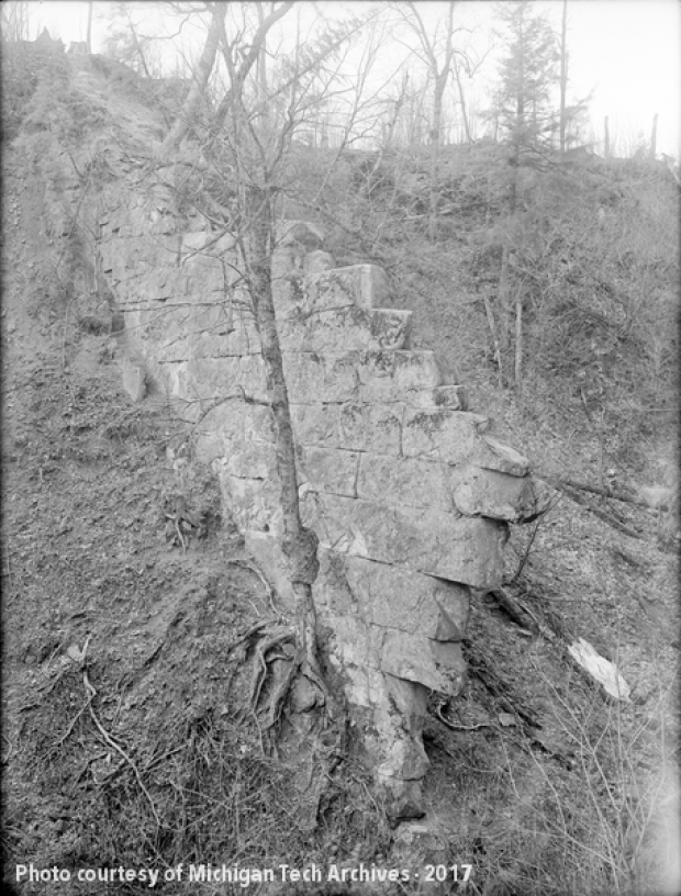 Image of brick wall emerging from a hillside