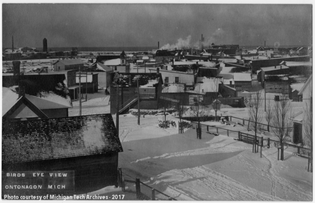 View of scattered wooden buildings in the snow