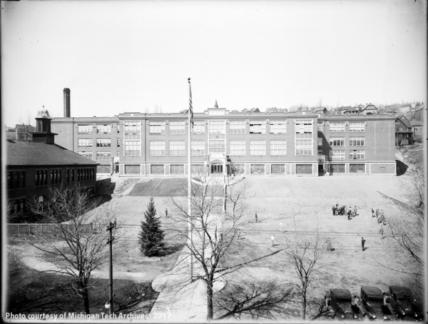 View of high school building with broad lawn