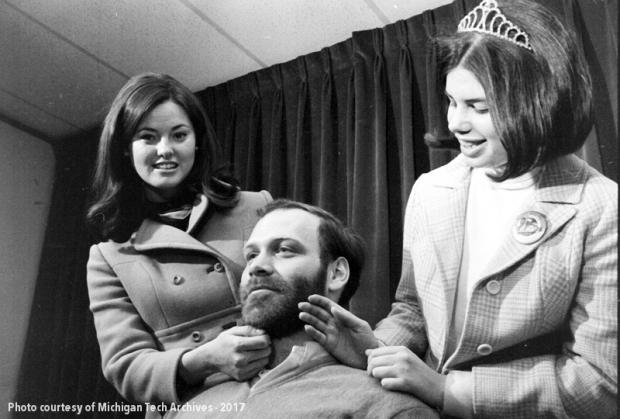 The 1970 carnival queen judges the beard contest.