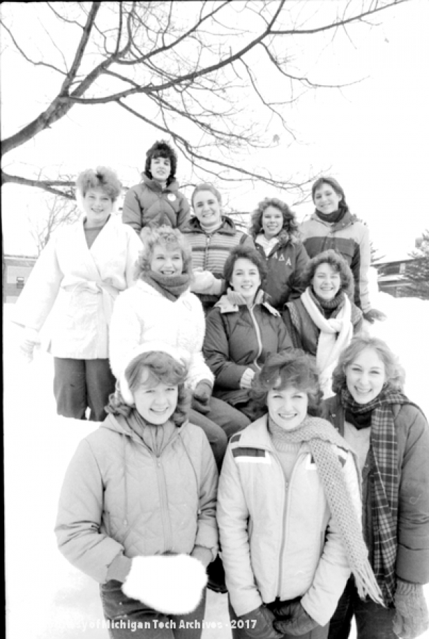 The 1983 queen candidates pose outside.
