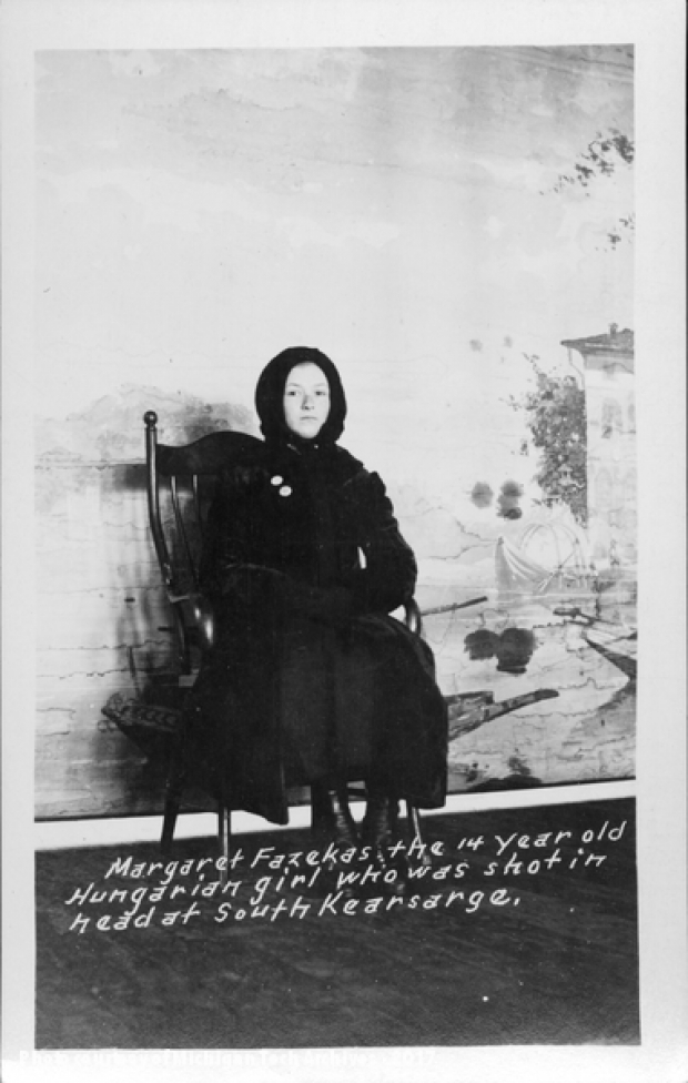 Image of girl in black seated on chair